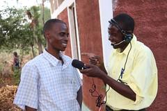 Festus Kaleli of Radio Mang'elete interviews a young farmer in Nthongoni constituency of Makueni region. Credit: Isaiah Esipisu/IPS