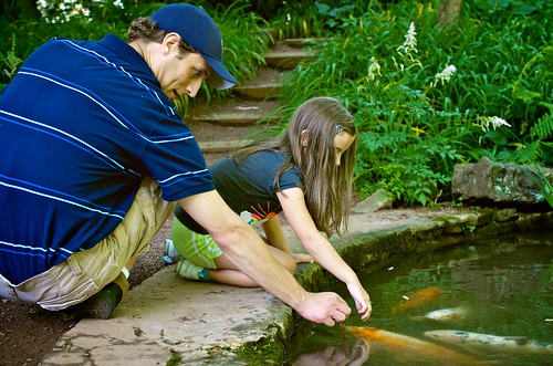 Petting the fish at the grotto.