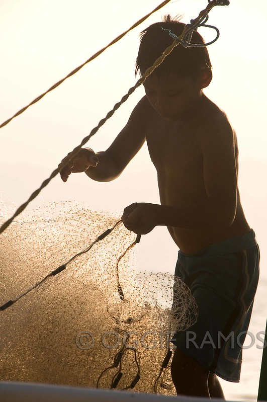 Cagbalete Quezon - Child Hauling Fishing Net at Sunset
