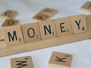 "Scrabble letters spelling ""MONEY"""