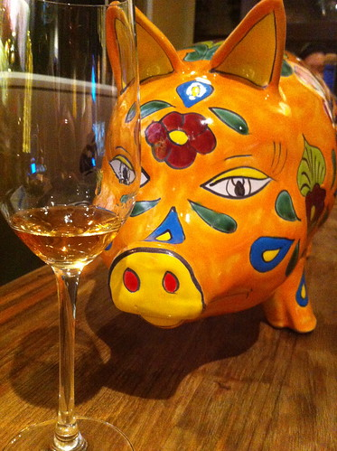 This piggy has his eye on a glass of tequila that's been aged for 36 months