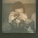 Resist shaking a polaroid picture by Armando Rotondo