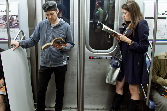 "on the left he's reading ""Trainspotting,"" by Irvine Welsh. on the right she's reading ""What I Talk About When I Talk About Running,"" by Haruki Murakami"
