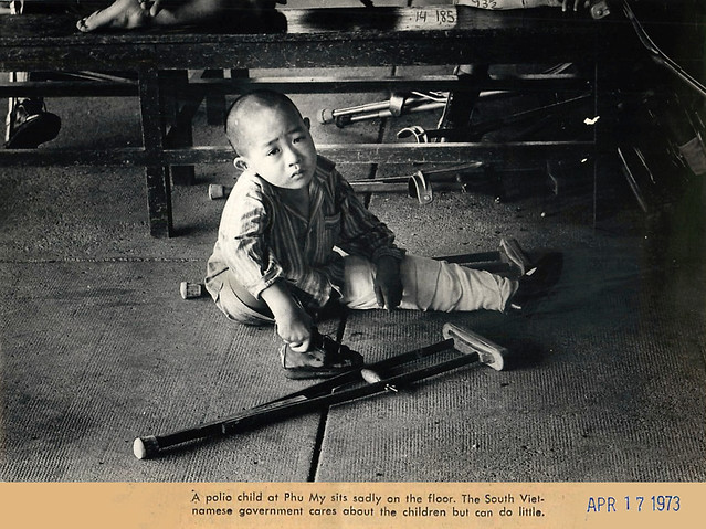 1973 Vietnamese War Orphan Sits on Floor in Phu My