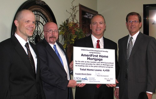 U.S. Department of Agriculture (USDA) Rural Development congratulates AmeriFirst Home Mortgage Company for its role as the number one Single Family Home (SFH) Guaranteed Home Loan provider for 2011 in Michigan on May 31, 2012. (L to R USDA Deputy Under Secretary for Rural Development (RD) Doug O'Brien, USDA RD Michigan State Director James Turner, AmeriFirst Co-Founder and President Mark A. Jones and AmeriFirst co-founder and Chief Executive Officer David Gahm). USDA Photo.