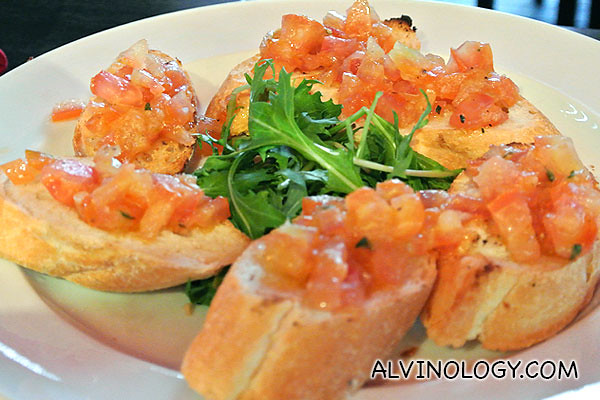 Bruschetta: Toasted 'Crostini' topped with Tomato, Garlic and Basil