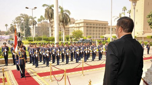 Egyptian President Dr. Mohamed Morsi reviews the military honor guard on June 30, 2012. Morsi has ordered parliament reopened in defiance of the supreme court and army. by Pan-African News Wire File Photos