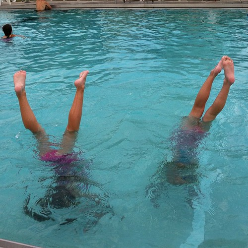 Sadly, the pool's chlorination has left the girls unable to distinguish up from down.