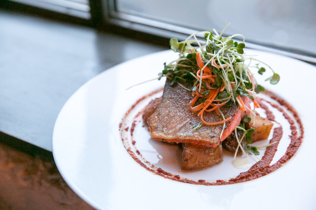 Wild Salmon ($28) Coho salmon, roasted lemon potatoes, sun-dried tomato purée, lemon vinaigrette seedling salad