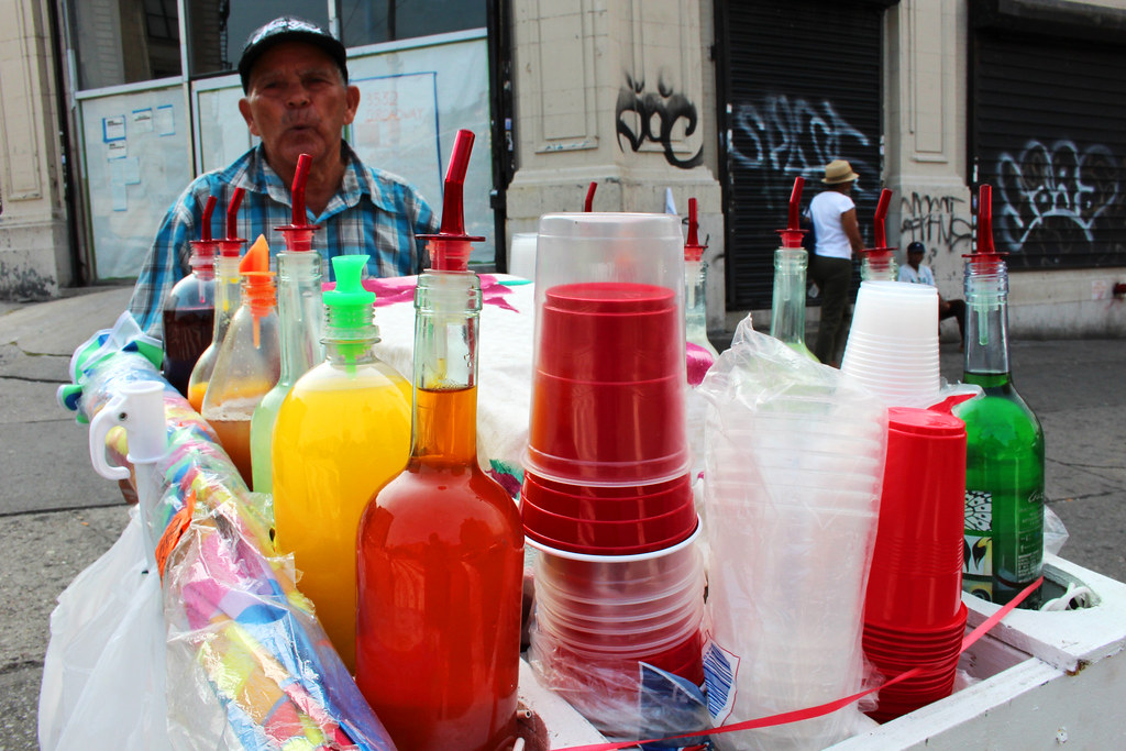 Man on corner of Broadway and 135th in West Harlem, New York, sells iced desserts on August 8, 2012. PHOTO: J. Duaine Hahn