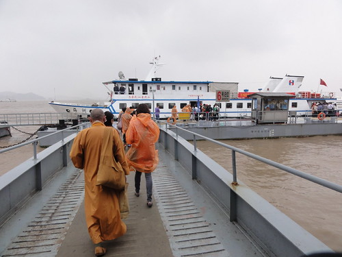 Walking to the boat with a monk ahead of me