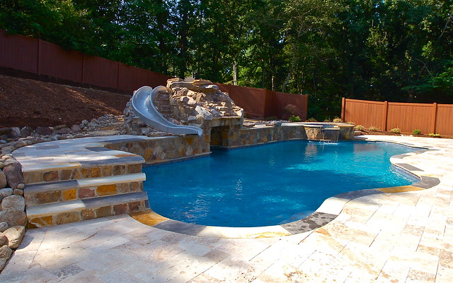 Custom pool and spa with rock waterfall and slide flickr for Pool and spa show charlotte nc