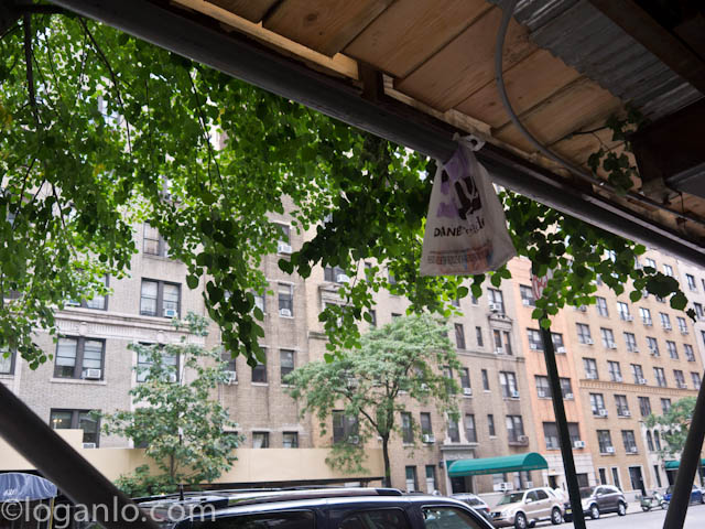 A strange bag of junk - or dog poop - tied to an awning in NYC