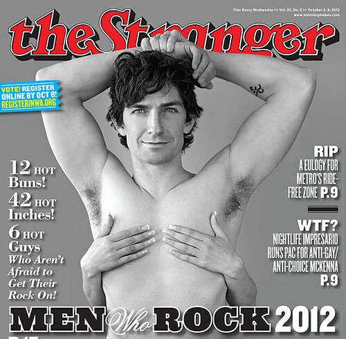 Stranger cover featuring a white shirtless man looking coyly at the camera. The words Men Who Rock are under him.