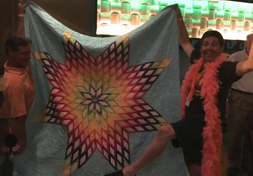 paradise50 helping Common Sense Mainer hold his quilt for display