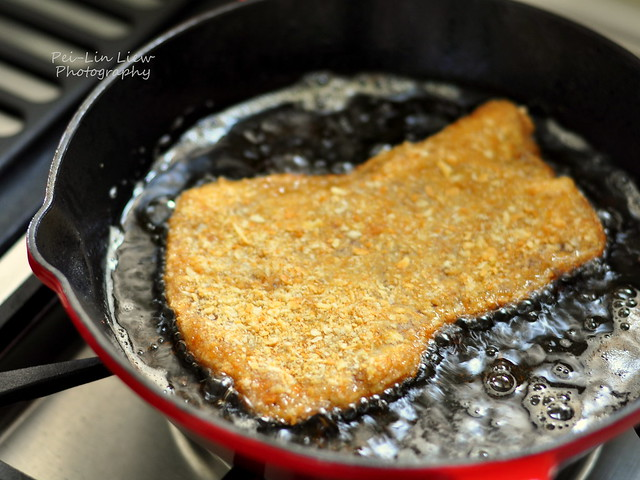 Pork paillard, marinated and breaded, shallow-frying for ...