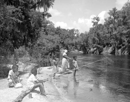 Thelma Boltin and the Bryant children fishing along the Suwannee River
