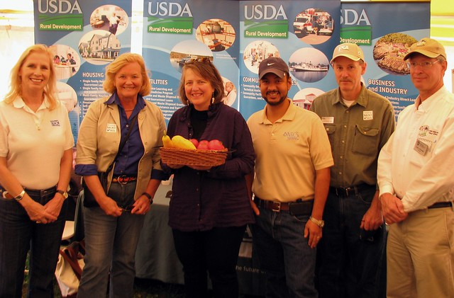 Gathering with USDA Leaders at the Common Ground Fair: USDA Rural Development Maine State Director Virginia Manuel; Maine Congresswoman Chellie Pingree; USDA Deputy Secretary Kathleen Merrigan (holding vegetables from State Office People's Garden); USDA Natural Resources Conservation Service State Conservationist Juan Hernandez; USDA Farm Service State Executive Director Don Todd III; and USDA National Agricultural Statistics Service Director Gary Keough.
