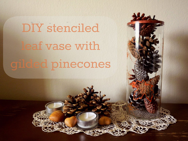 Stenciled leaf vase with gilded pinecones