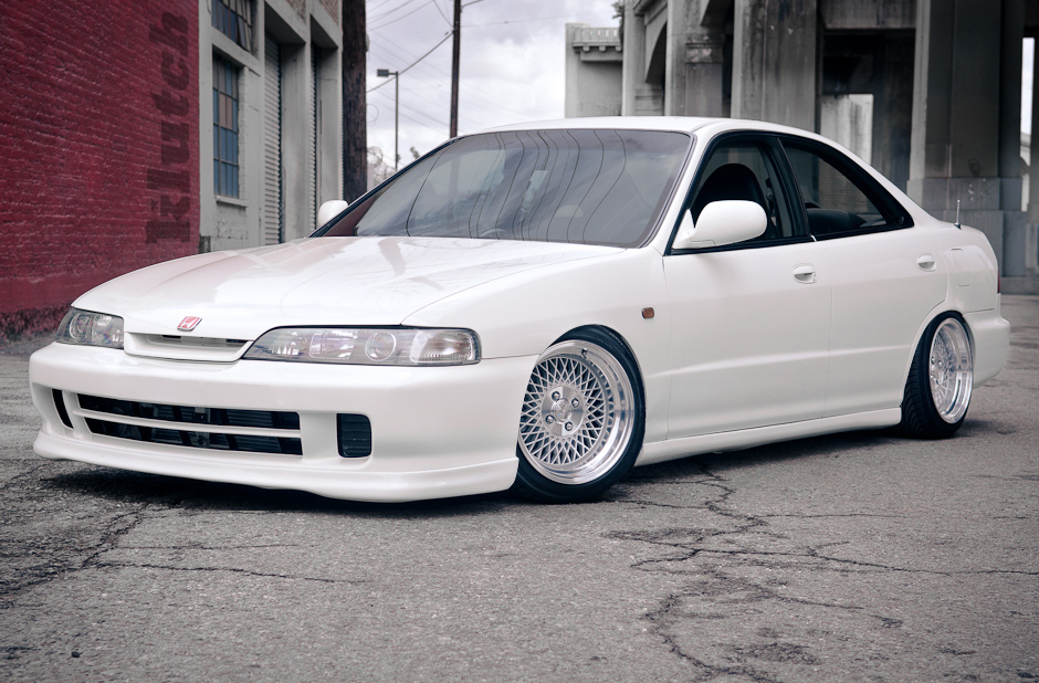 "white acura integra with 15x8.5"" klutch wheels sl1 with aggressive fitment stanced stance with stretched tires"