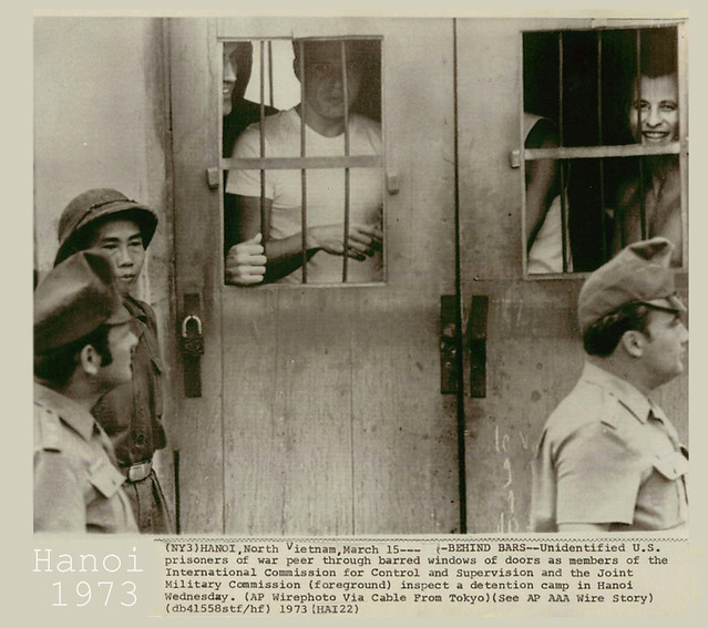 1973 U.S. Prisoners Peer Thru Bars At POW Camp In Hanoi