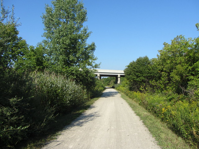Cycling under railway overpass