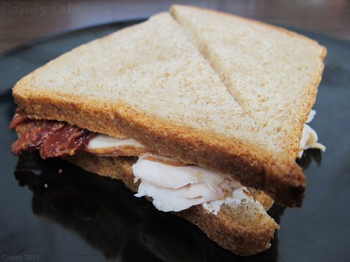 Turkey, bacon, and cream cheese sandwich on wheat by Coyoty