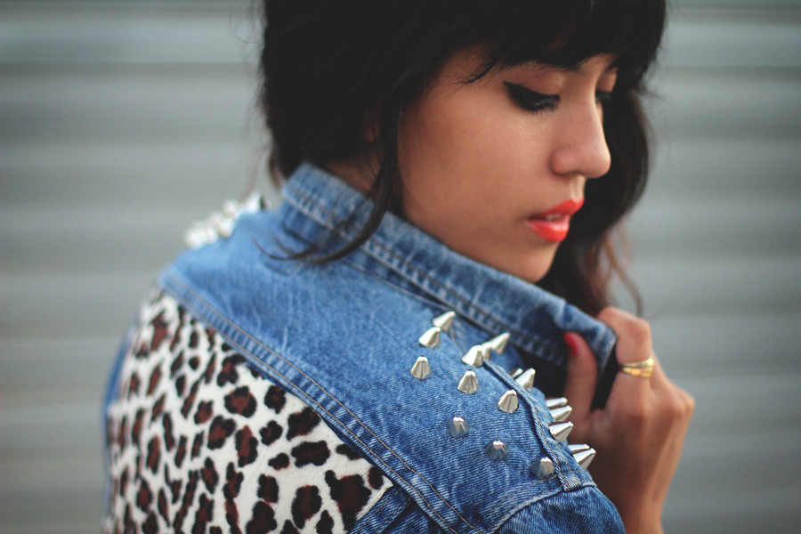 Tarte Vintage spike studded shoulder denim jacket with leopard cheetah print on back at shoptarte.com