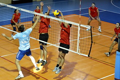 wallyball(0.0), volleyball player(1.0), ball over a net games(1.0), volleyball(1.0), sports(1.0), team sport(1.0), ball game(1.0),