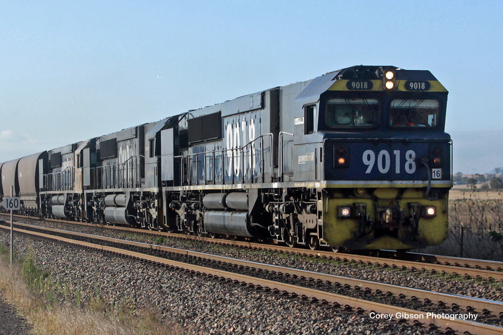 9018, 9013 & 9033 with an empty coal train by Corey Gibson