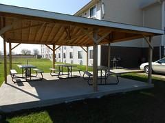 patio(0.0), tent(0.0), outdoor structure(1.0), canopy(1.0), property(1.0), pergola(1.0), pavilion(1.0), gazebo(1.0), villa(1.0),