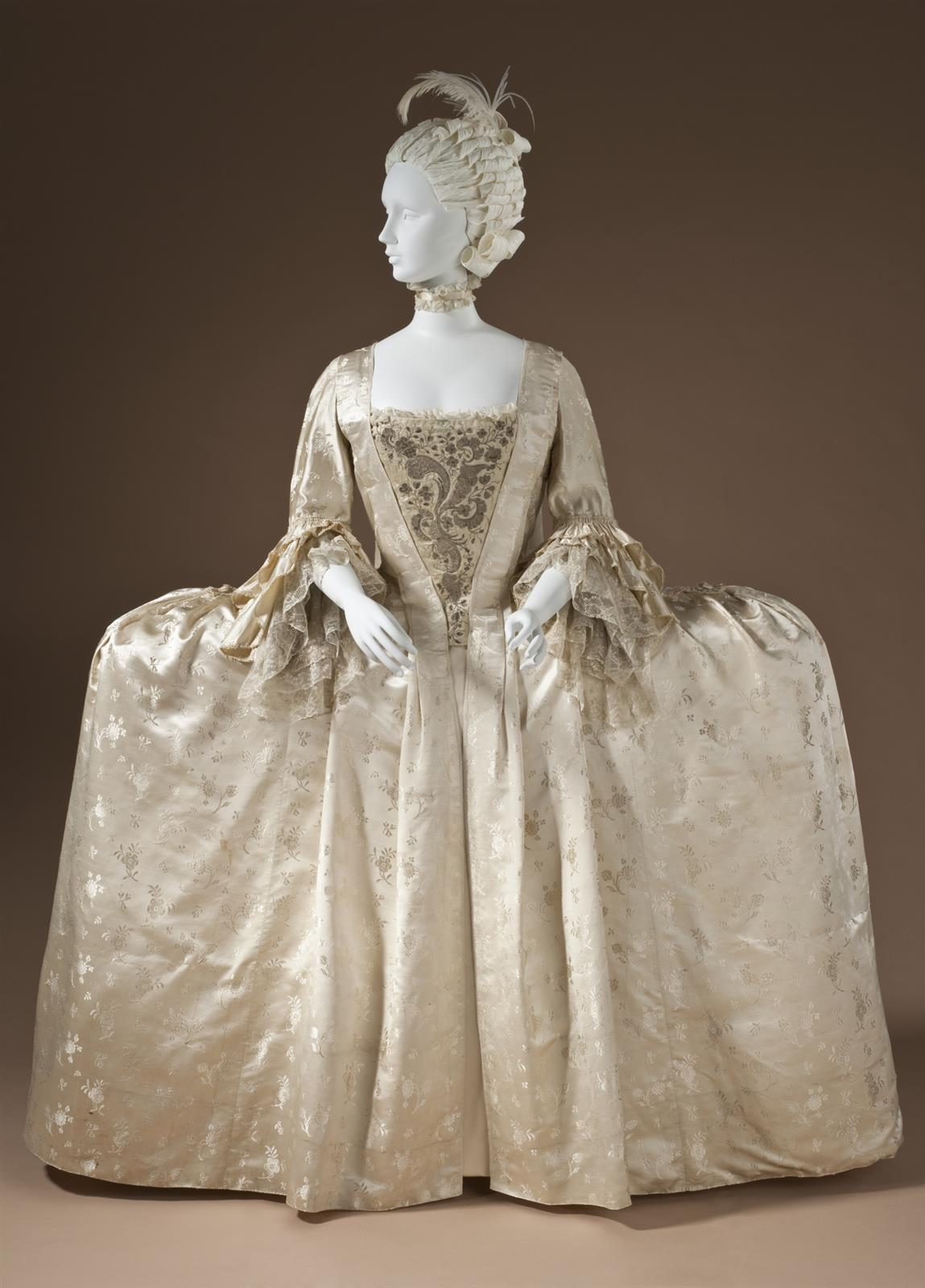1765 Robe à la française. Silk satin with weft-float patterning and silk passementerie. LACMA