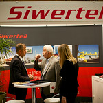 Delegates at the Siwertell exhibition booth