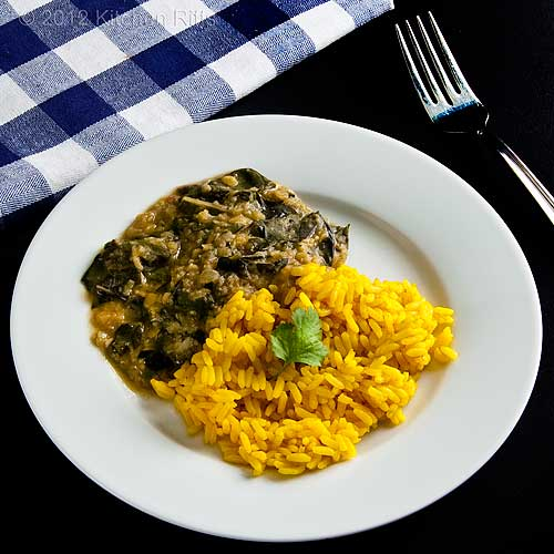Aromatic Indian Yellow Rice with Dal on Plate, with Napkin and Fork