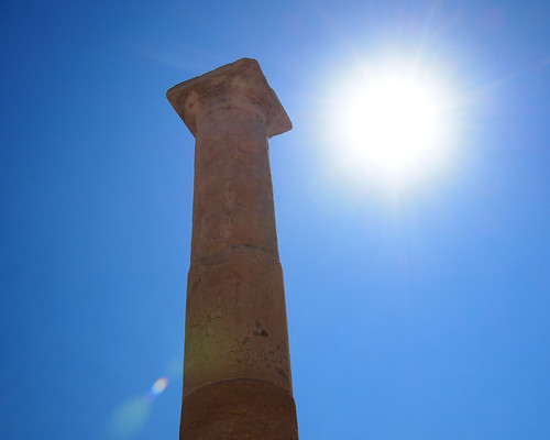 A limestone column stands proud in the sun at Amathous Ruins