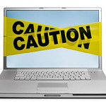 caution laptop