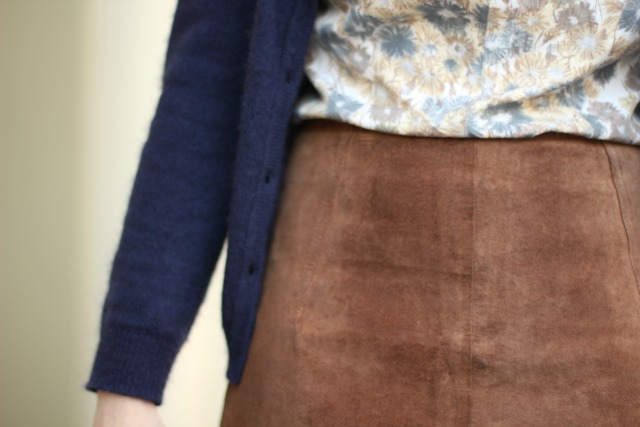 brown suede skirt and floral blouse