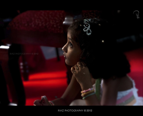 A random capture at a recent wedding shoot. The little girl is bored by the speeches.