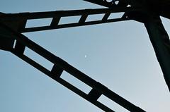 Moon through bridge