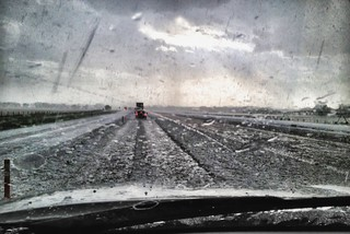 Caught in a single-cell, insane thunderstorm on I-80.  Traffic came to a stop right on I-80.  Inches of ice from the accompanying hailstorm.  Ogallala, NE.