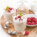 healthy dessert with oatmeal, whipped cream and raspberries
