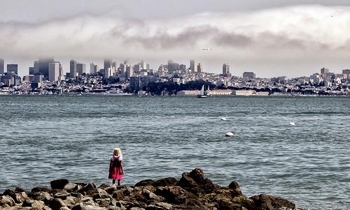 girl looking at the SF Bay