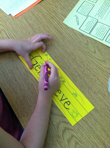 The first grader decorates her name card!