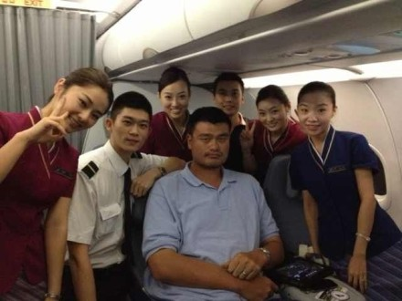 September 28th, 2012 - the flight crew on Yao Ming's flight poses for a picture with him as he returns back to China from Perth, Australia