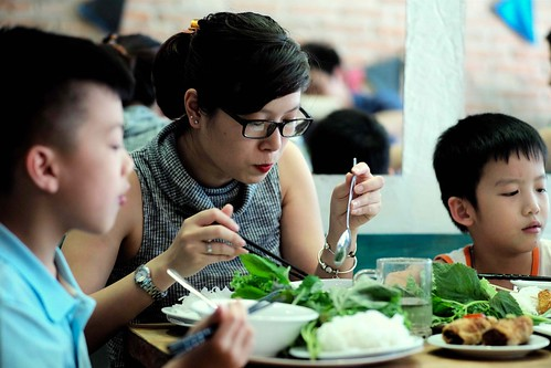Vietnamese mum eating Bun Cha with her children