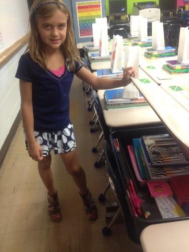 Karli organizing her desk.
