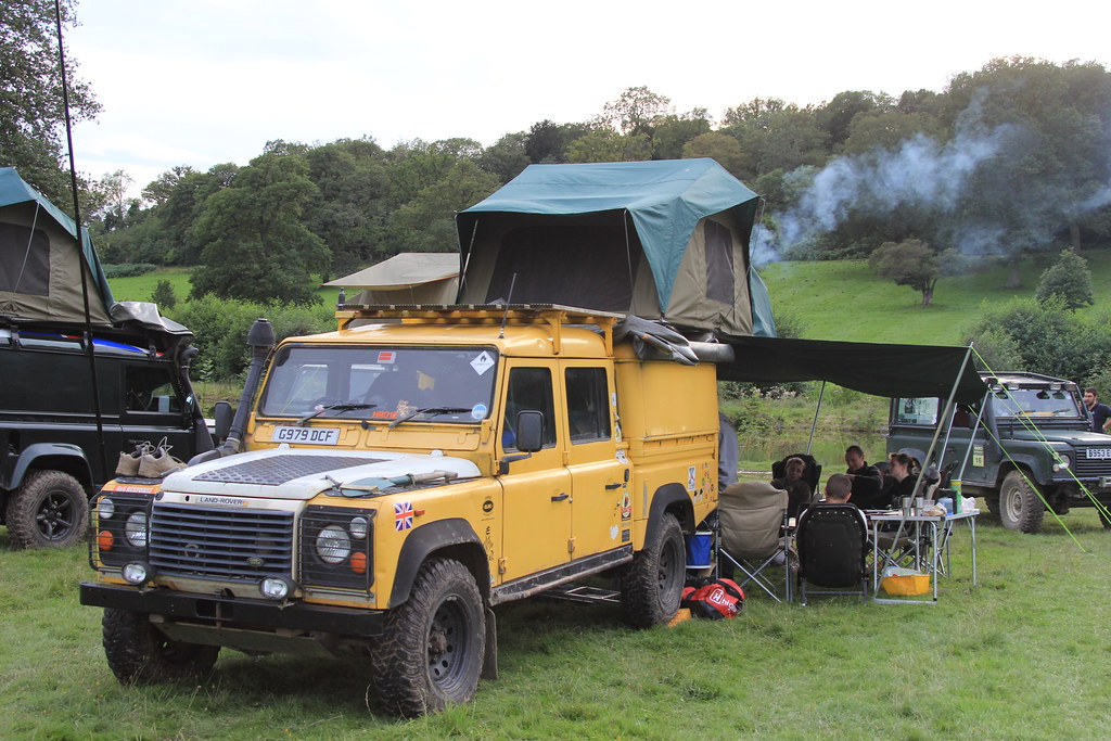 Myway Serengeti rooftent with veranda, windbreak and Camping Solutions' Frontier Stove