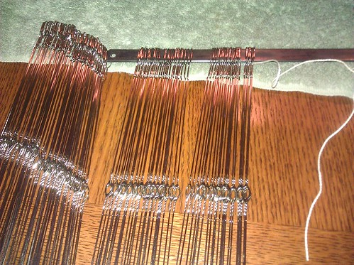 The last 125 heddles for the final shaft