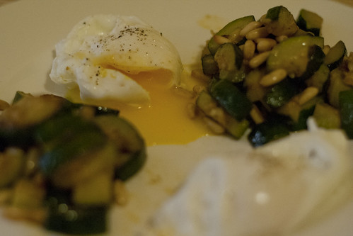 Poached eggs  with courgettes and pine nuts