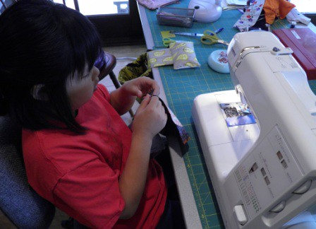 Malia working on a zippered bag